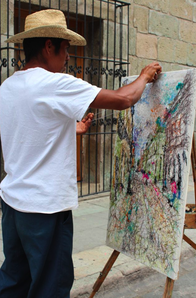 Local art. From those who are making art in the streets, like the man in the photo who is making an art with threads, to the various museums that have given fame to the whole state of being one of the most innovative and creative ones. I believe the magic comes by the combination of great ideas with Mexican folklore art!