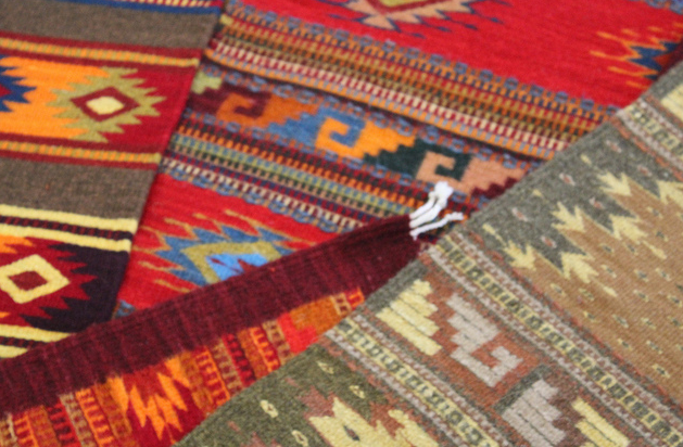 Talking and admiring the traditional rugs that family weavers from Teotitlan, Oaxaca produce. I learnt how long they take when they make one single piece and it made me realize how unfair bargaining can be